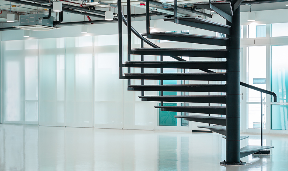Black modern spiral stair in business office with window citysca